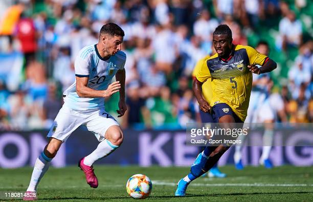 Jhegson Mendez of the Ecuador competes for the ball with Lucas Alario of Argentina during the international friendly match between Ecuador and...