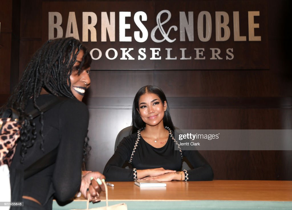 Jhene Aiko poses for a photo with a fan during her 2 Fish Poetry Book Signing at Barnes and Noble at The Grove on February 20, 2018 in Los Angeles, California.