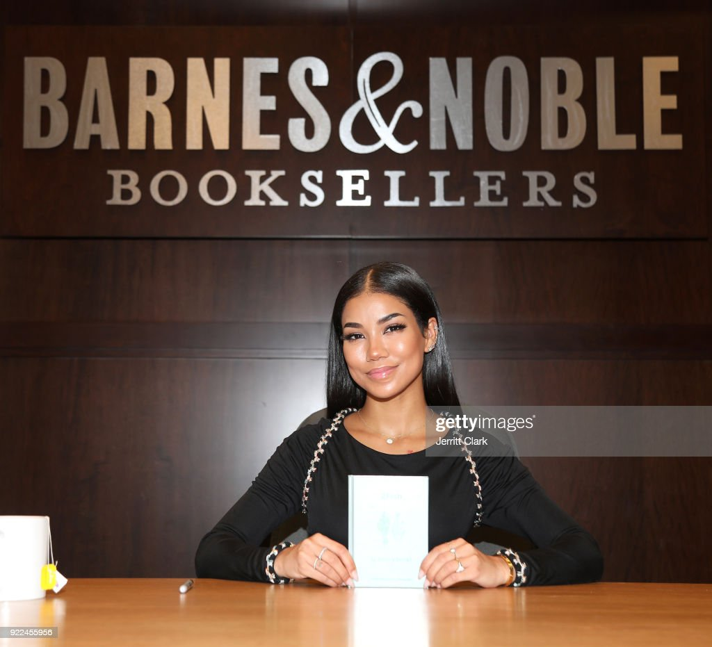Jhene Aiko poses with a copy of her 2 Fish Poetry Book during a Book Signing at Barnes and Noble at The Grove on February 20, 2018 in Los Angeles, California.