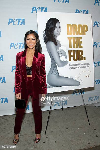 Jhene Aiko unveils her 'Rather Go Naked Than Wear Fur' ad during opening night of PETA's 'Naked Ambition' exhibit at PETA Empathy Center on December...