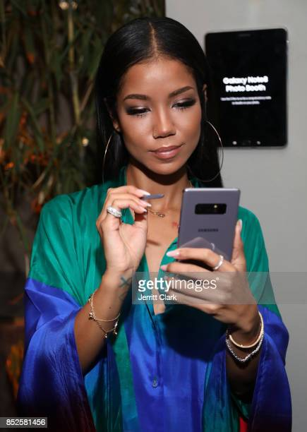 Jhene Aiko uses a Samsung Galaxy Note 8 during her a TRIP launch party powered by Samsung at EB Gallery on September 22 2017 in Los Angeles California