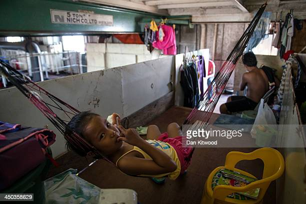 Jhenina Dorian relaxes in a hammock in the hull of a tanker that ran aground in a particularly badly damaged part of Tacloban on November 18 2013 in...
