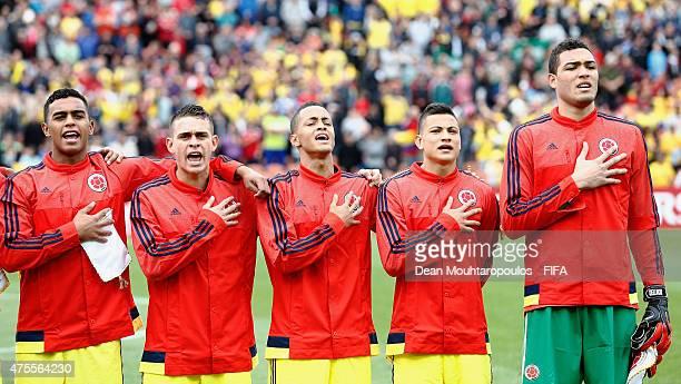 Jhoan Sebastian Ayala Rafael Santos Borre Joao Rodriguez Alexis Zapata and Alvaro David Montero of Colombia sing their national anthem prior to the...