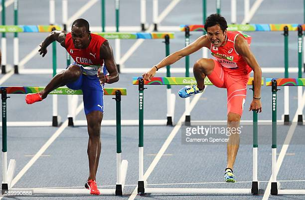 Jhoanis Portilla of Cuba and Wataru Yazawa of Japan compete during the Men's 110m Hurdles Round 1 - Heat 6 on Day 10 of the Rio 2016 Olympic Games at...