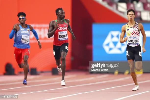 Jhon Alejandro Perlaza of Colombia, Emmanuel Kipkurui Korir of Kenya and Jonathan Sacoor of Belgium compete in the Men's 400 Metres heats during day...