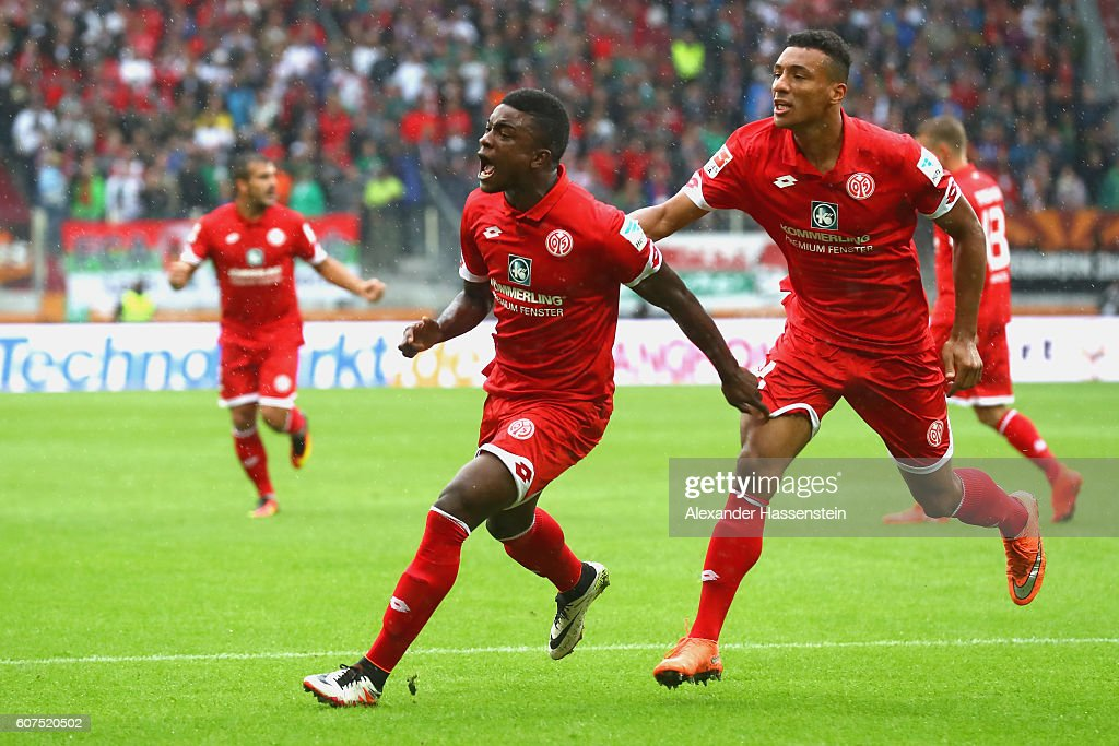 Jhon Andrés Córdoba Copete (L) of Mainz celebrates scoring the opening goal with his team mate Karim Onisiwo during the Bundesliga match between FC Augsburg and 1. FSV Mainz 05 at WWK Arena on September 18, 2016 in Augsburg, Germany.