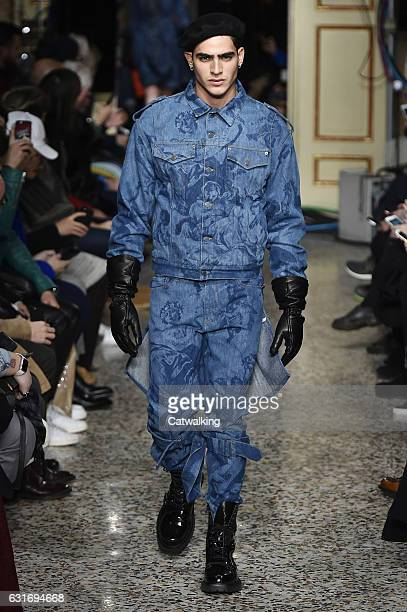 Jhon Burjack walks the runway at the Moschino Autumn Winter 2017 fashion show during Milan Menswear Fashion Week on January 14 2017 in Milan Italy