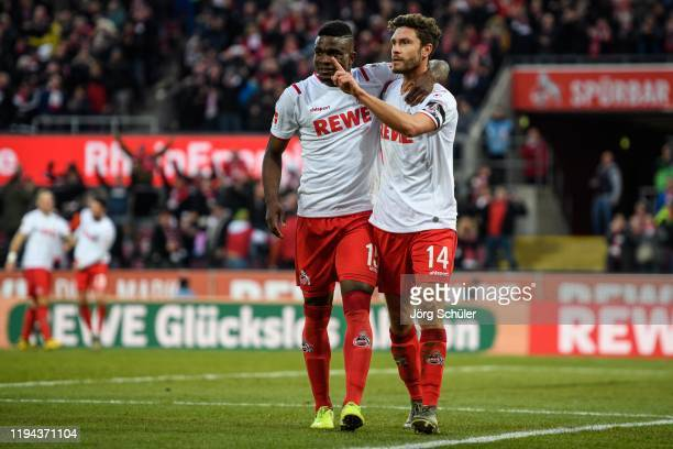 Jhon Cordoba and Jonas Hector of Cologne celebrate after their teams third goal during the Bundesliga match between 1 FC Koeln and VfL Wolfsburg at...