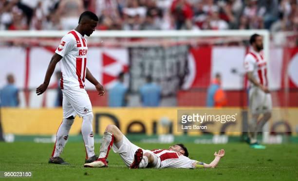 Jhon Cordoba and Jonas Hector of Koeln look dejected after the Bundesliga match between 1 FC Koeln and FC Schalke 04 at RheinEnergieStadion on April...