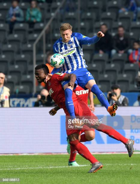 Jhon Cordoba of 1 FC Koeln and Mitchell Weiser of Hertha BSC during the Bundesliga game between Hertha BSC and 1st FC Koeln at Olympiastadion on...