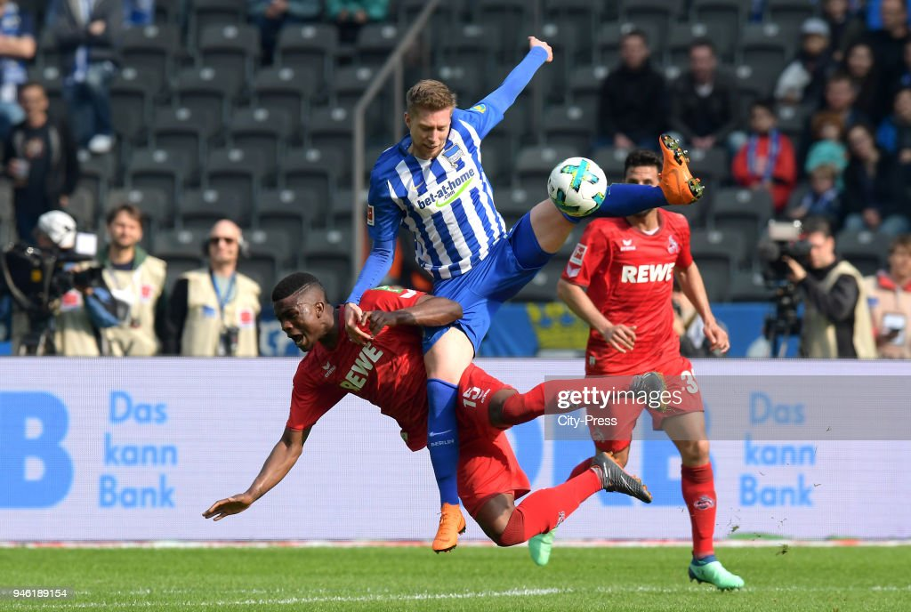 Jhon Cordoba of 1. FC Koeln and Mitchell Weiser of Hertha BSC during the Bundesliga game between Hertha BSC and 1st FC Koeln at Olympiastadion on April 14, 2018 in Berlin, Germany.