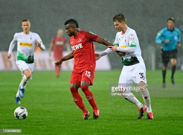 Jhon Cordoba of 1 FC Koeln and Nico Elvedi of Borussia Moenchengladbach battle for the ball during the Bundesliga match between Borussia...