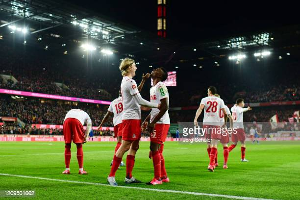 Jhon Cordoba of 1. FC Koeln celebrates with teammate Sebastiaan Bornauw after scoring his team's second goal during the Bundesliga match between 1....