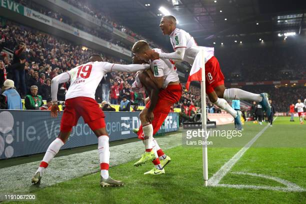 Jhon Cordoba of 1. FC Koeln celebrates with teammates after scoring his team's first goal during the Bundesliga match between 1. FC Koeln and FC...