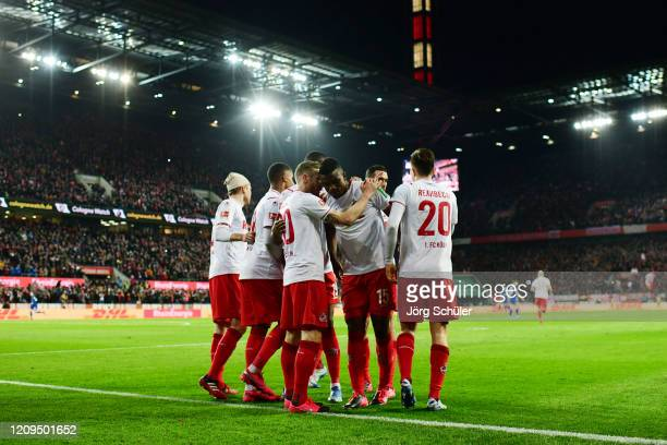 Jhon Cordoba of 1. FC Koeln celebrates with teammates after scoring his team's second goal during the Bundesliga match between 1. FC Koeln and FC...