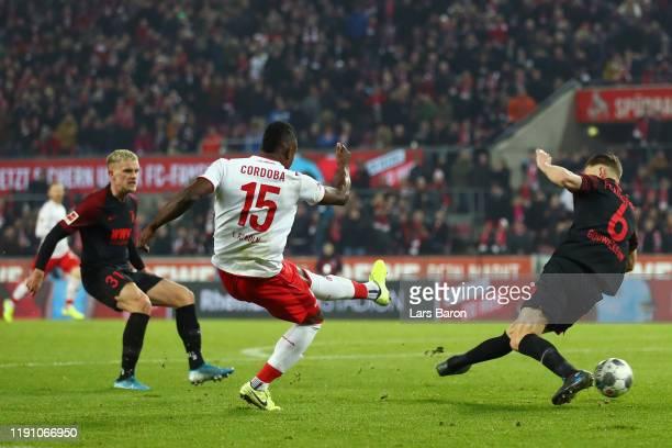 Jhon Cordoba of 1 FC Koeln scores his team's first goal during the Bundesliga match between 1 FC Koeln and FC Augsburg at RheinEnergieStadion on...