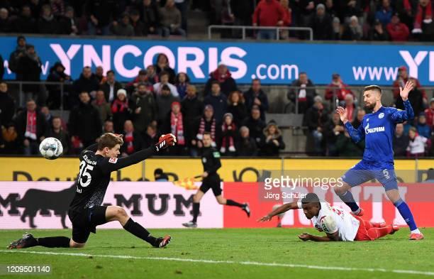 Jhon Cordoba of 1. FC Koeln scores his team's second goal past Alexander Nuebel of FC Schalke 04 04during the Bundesliga match between 1. FC Koeln...