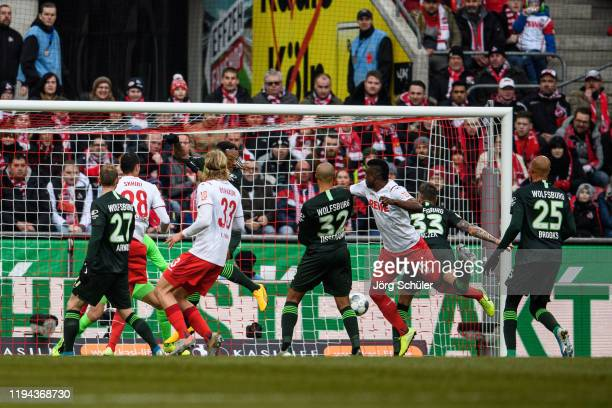 Jhon Cordoba of Cologne scores the 10 lead during the Bundesliga match between 1 FC Koeln and VfL Wolfsburg at RheinEnergieStadion on January 18 2020...