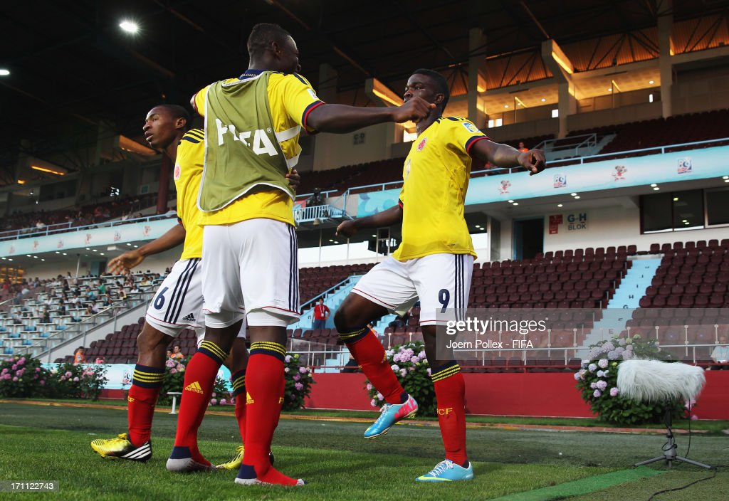 Jhon Cordoba (R) of Colombia celebrates with his team mate after scoring his team's first goal during the FIFA U-20 World Cup Group C match between Colombia and Australia at Huseyin Avni Aker Stadium on June 22, 2013 in Trabzon, Turkey.