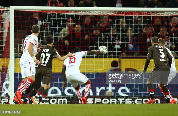 Jhon Cordoba of FC Koln scores his team's first goal during the Second Bundesliga match between 1 FC Koeln and FC St Pauli at RheinEnergieStadion on...