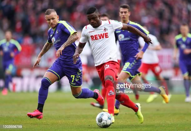Jhon Cordoba of FC Koln tackles with Jonathan Schmid of SC Freiburg during the Bundesliga match between 1 FC Koeln and SportClub Freiburg at...