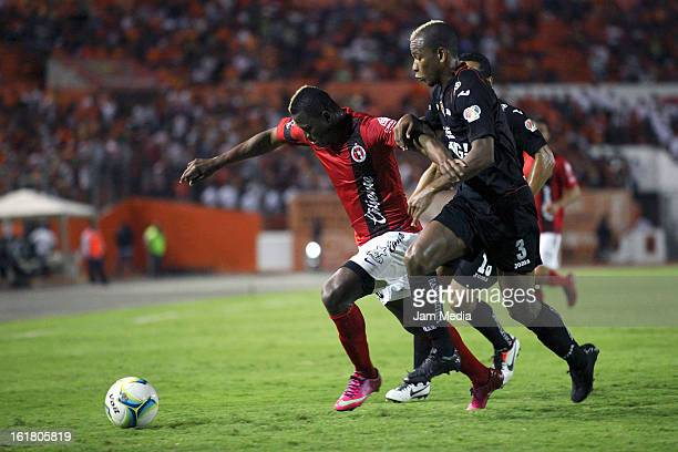 Jhon Cordoba of Jaguares struggles for the ball with Duvier Riascos of Tijuana during the Clausura 2013 Liga MX at Victor Manuel Reyna Stadium on...