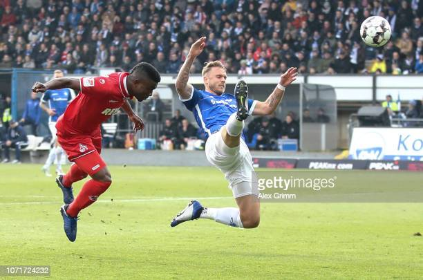 Jhon Cordoba of Koeln attempts to score with a header against Marcel Franke of Darmstadt during the Second Bundesliga match between SV Darmstadt 98...
