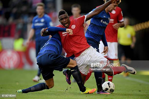 Jhon Cordoba of Mainz and Alexander Milosevic of Darmstadt battle for the ball during the Bundesliga match between 1 FSV Mainz 05 and SV Darmstadt 98...