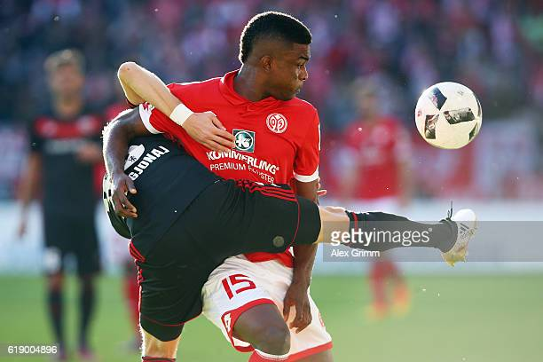 Jhon Cordoba of Mainz is challenged by Florent Hadergjonaj of Ingolstadt during the Bundesliga match between 1 FSV Mainz 05 and FC Ingolstadt 04 at...