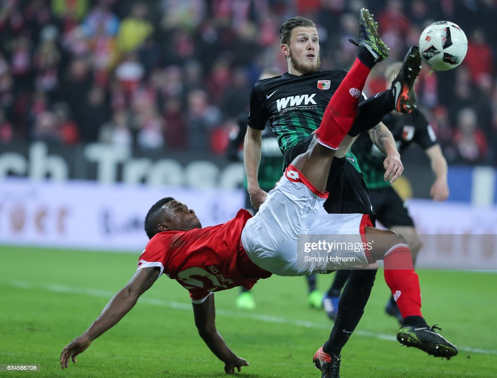 Jhon Cordoba of Mainz is challenged by Jeffrey Gouweleeuw of Augsburg during the Bundesliga match between 1. FSV Mainz 05 and FC Augsburg at Opel Arena on February 10, 2017 in Mainz, Germany.