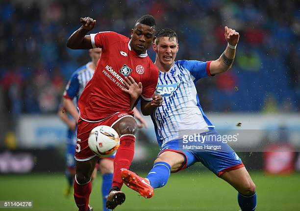 Jhon Cordoba of Mainz is challenged by Niklas Suele of Hoffenheim during the Bundesliga match between 1899 Hoffenheim and 1 FSV Mainz 05 at Wirsol...
