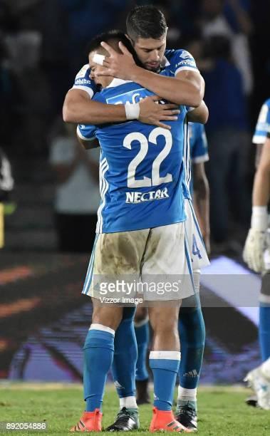 Jhon Duque Arias and Matias De Los Santos of Millonarios celebrate after the first leg match between Millonarios and Santa Fe as part of the Liga...