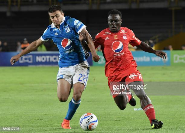 Jhon Duque Arias of Millonarios fights for the ball with Jonny Mosquera of America de Cali during the second leg match between Millonarios and...