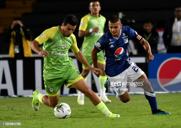 Jhon Duque of Millonarios and Pablo Bueno of Jaguares de Cordoba F. C. Fight for the ball, during a match between Millonarios and Jaguares F.C. As...