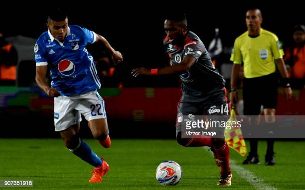 Jhon Duque of Millonarios fights for the ball with Ivan Velez of America de Cali during the friendly match between Millonarios and America de Cali as...