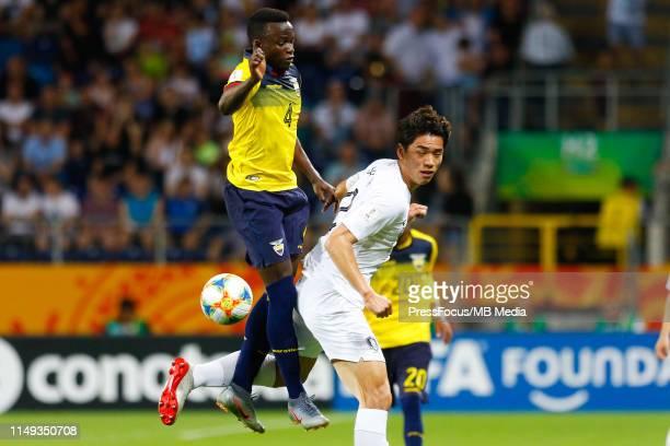 Jhon Espinoza of Ecuador competes for the ball with Oh Sehun of Korea Republic during the FIFA U20 World Cup Semi Final match between Ecuador and...