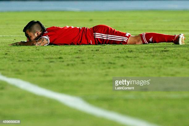 Jhon Fredy Perez of America de Cali lies on the grass after loosing the match between America de Cali and Rionegro as part of sixth round of...