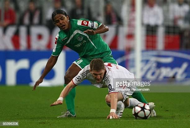 Jhon Jairo Culma of Haifa challenges Bastian Schweinsteiger of Bayern Muenchen during the UEFA Champions League Group A match between FC Bayern...