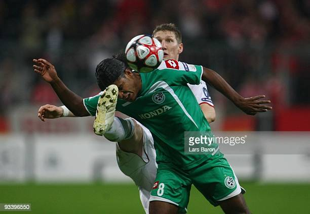 Jhon Jairo Culma of Haifa is challenged by Bastian Schweinsteiger of Bayern during the UEFA Champions League Group A match between FC Bayern Muenchen...