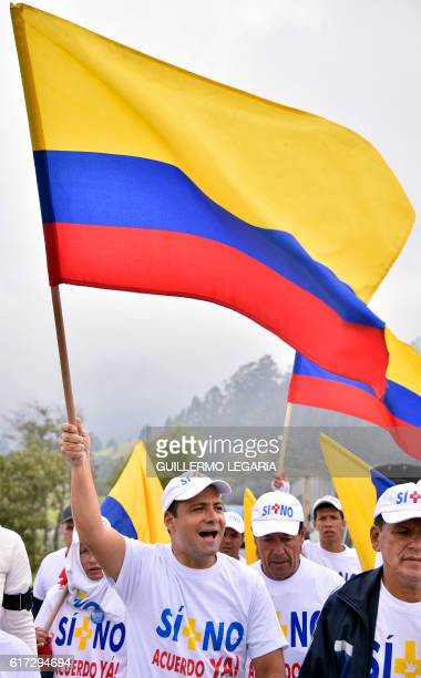 Jhon Jairo Hoyos son of former Valle del Cauca's deputy Jairo Hoyos kidnapped and killed by the FARC waves a flag while leading the 'Yes No Agreement...