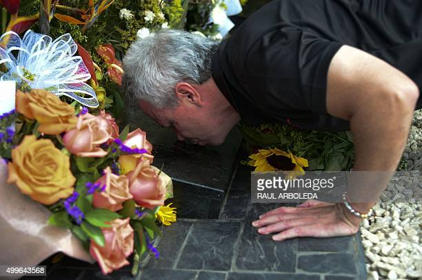"Jhon Jairo Velasquez, A.K.A ""Popeye"", visits the tomb of Colombian drug lord Pablo Escobar at the Montesacro cemetery in Medellin, Antioquia..."
