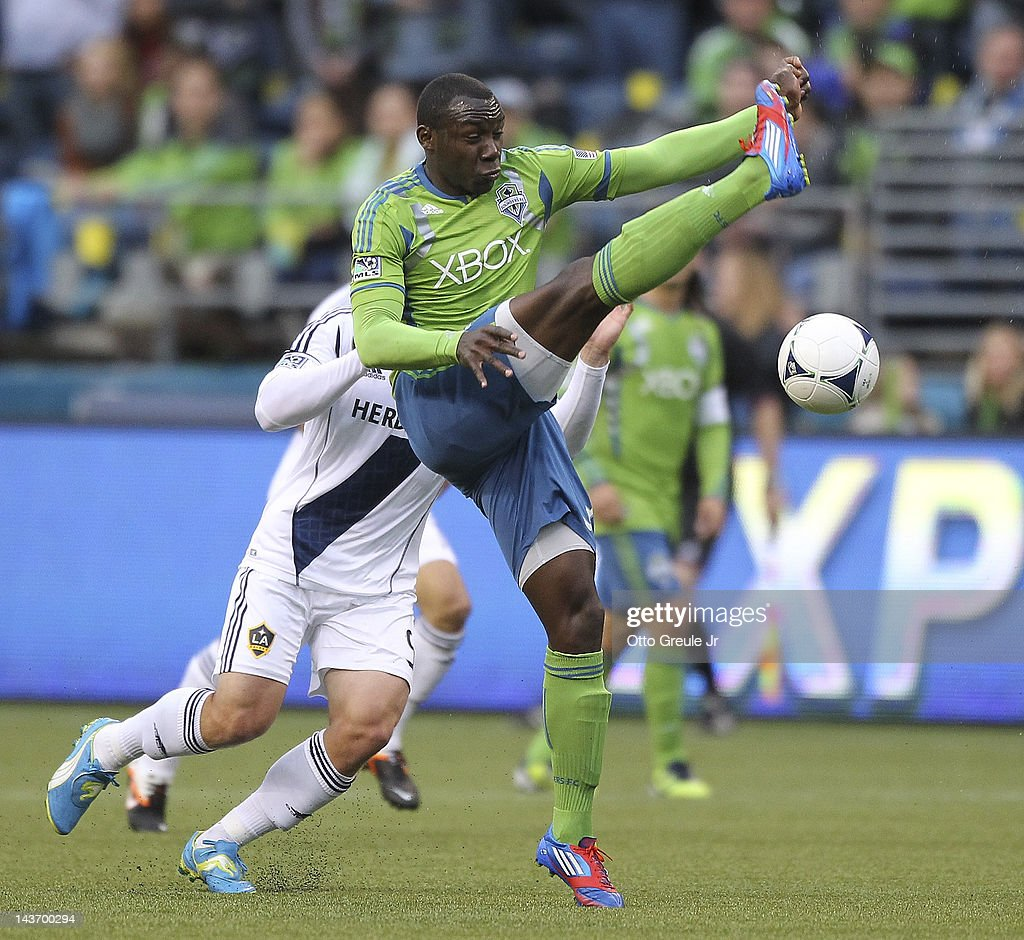 Jhon Kennedy Hurtado #34 of of the Seattle Sounders controls the ball against Chad Barrett #9 of the Los Angeles Galaxy at CenturyLink Field on May 2, 2012 in Seattle, Washington.