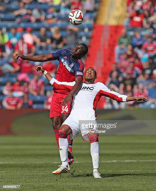 Jhon Kennedy Hurtado of the Chicago Fire heads the ball over Teal Bunbury of the New England Revolution during an MLS match at Toyota Park on April19...