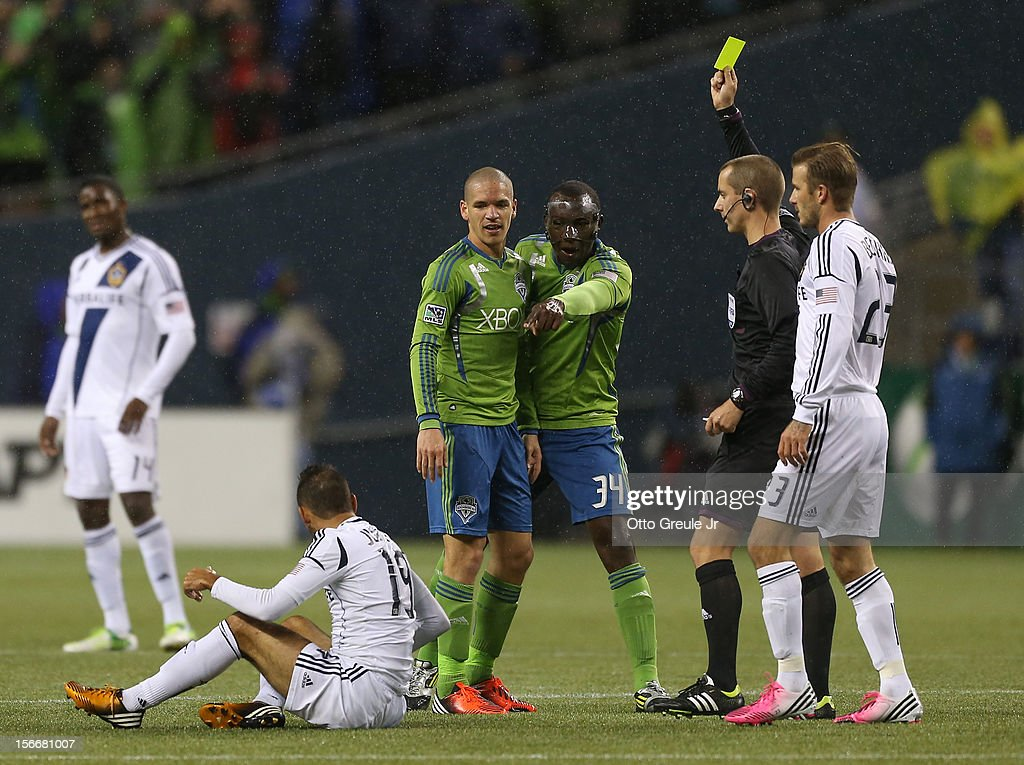 Jhon Kennedy Hurtado #34 of the Seattle Sounders FC complains to the referee after Osvaldo Alonso #6 was issued a yellow card while battling Juninho #19 of the Los Angeles Galaxy during Leg 2 of the Western Conference Championship at CenturyLink Field on November 18, 2012 in Seattle, Washington. The Galaxy defeated the Sounders 2-1, winning the aggregate playoff 4-2.