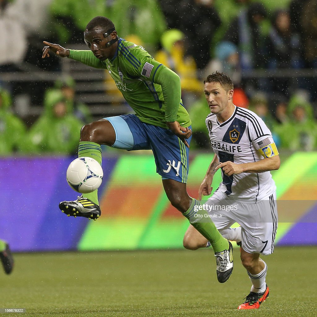 Jhon Kennedy Hurtado #34 of the Seattle Sounders FC dribbles against Robbie Keane #7 of the Los Angeles Galaxy during Leg 2 of the Western Conference Championship at CenturyLink Field on November 18, 2012 in Seattle, Washington. The Galaxy defeated the Sounders 2-1, winning the aggregate playoff 4-2.