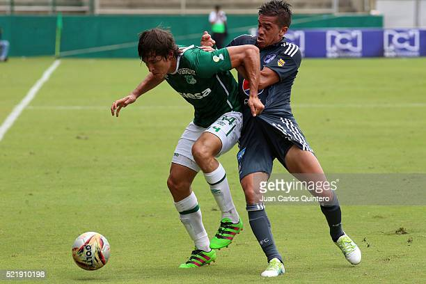 Jhon Lozano of Cali and Maximiliano Nuñez of Cali fight for the ball during a match between Deportivo Cali and Millonarios as part of round 13 of...