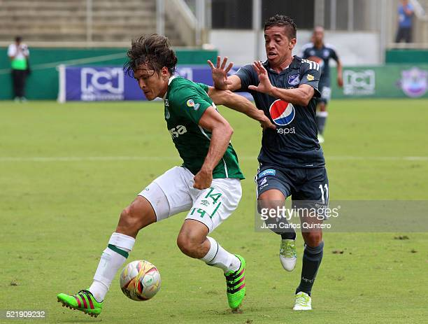 Jhon Lozano Of Cali and Maximiliano Nuñez of Millonarios struggle for the ball during a match between Deportivo Cali and Millonarios as part of round...