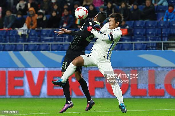 Jhon Mosquera of Atletico Nacional and Yasushi Endo of Kashima Antlers in action during the semi final match between Atletico Nacional and Kashima...