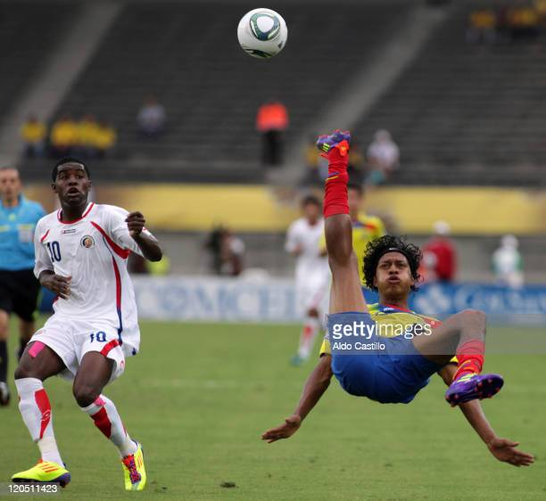 Jhon Narvaez from Ecuador fights for the ball with Joel Campbell from Costa Rica during a match of Group C between Ecuador and Costa Rica as part of...