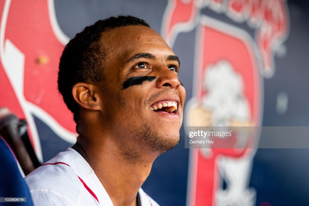 Jhon Nunez #20 of the Portland Sea Dogs chats with his teammates during a game between the Portland Sea Dogs and the New Hampshire Fisher Cats at Hadlock Field on July 15, 2018 in Portland, Maine.